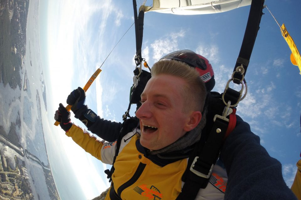 Tandem skydiver with blonde hair and tandem skydiving instructor jump near Myrtle Beach