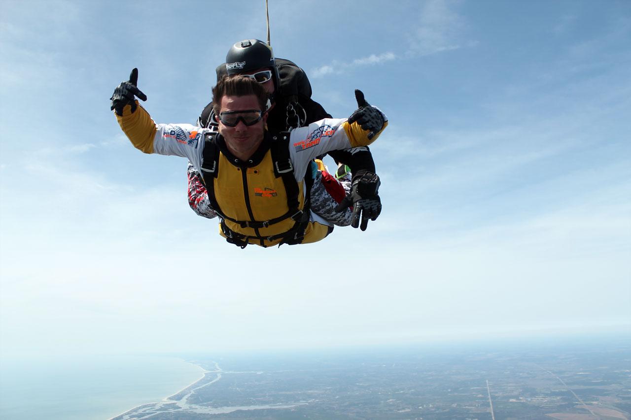 Tandem skydiving pair in freefall above Oak Island, NC