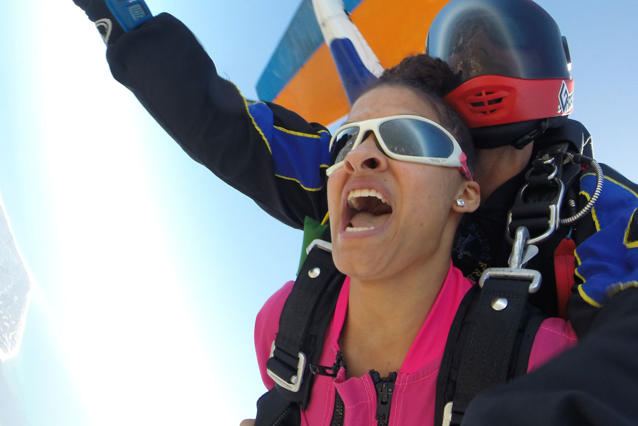 Tandem skydiving student yelling with excitement as they exit the aircraft